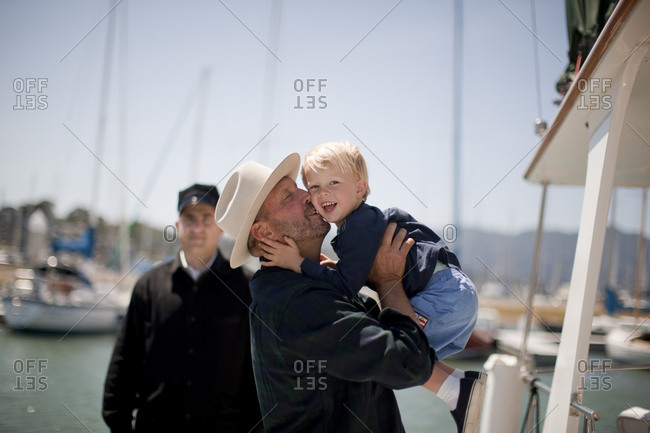 Father welcoming his young son off a boat