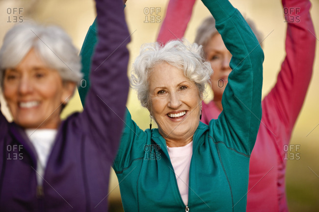 Portrait of three senior women doing yoga together.
