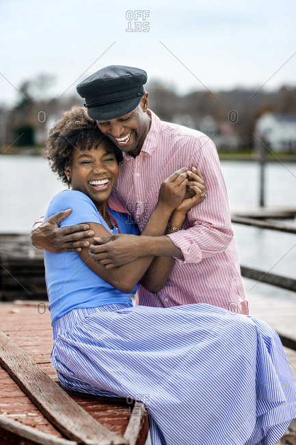 Couple enjoys romantic day at seaside.