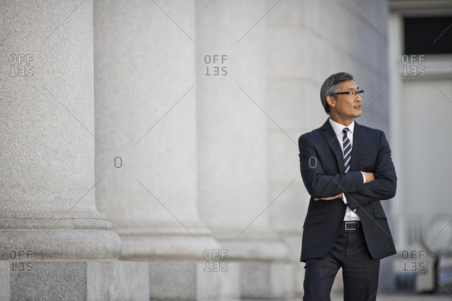Businessman standing in street.