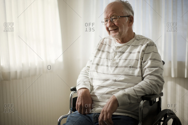 Laughing senior man sitting in a wheelchair.