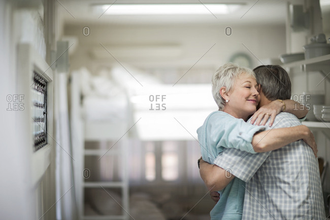 Affectionate mature couple share a tender embrace.