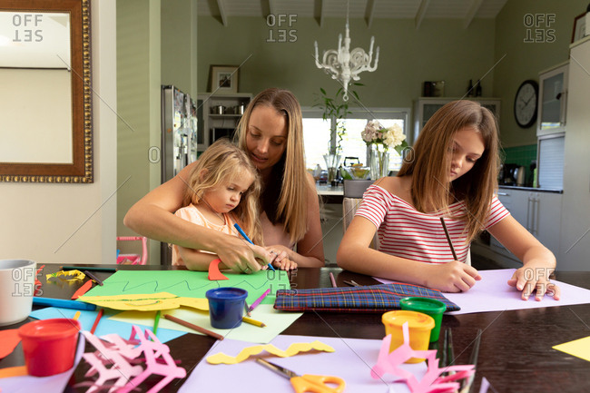 Young mother enjoying time at home with her daughters