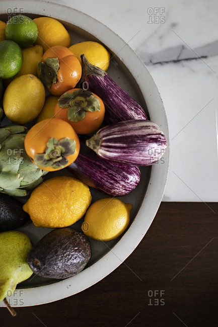 Bowl filled with fresh fruits and vegetables