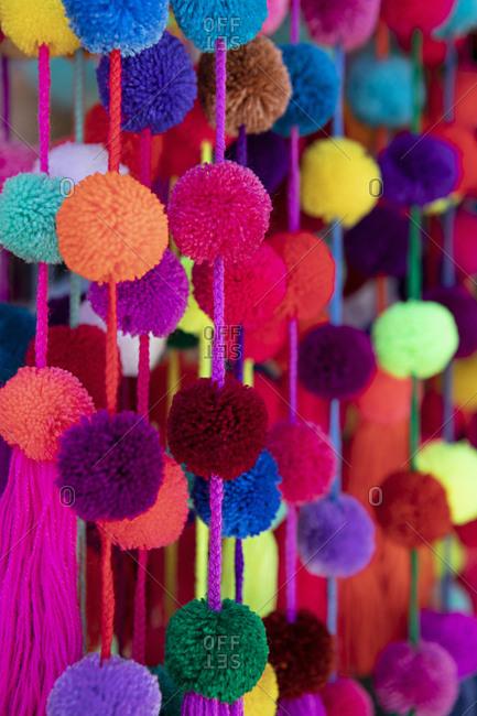 Colorful hanging pom poms
