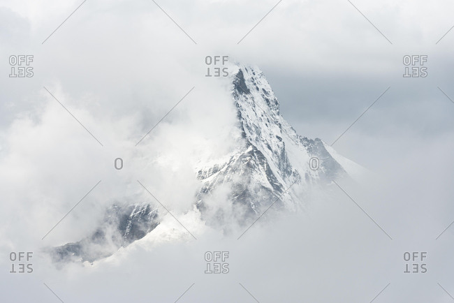 Switzerland, Valais, Zermatt, Matterhorn mountain seen through clouds