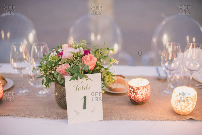Beautiful floral centerpiece and decor with table 1 card at a wedding reception