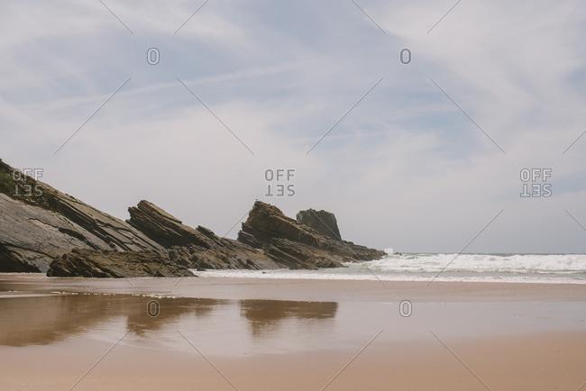 Atlantic Ocean waves rolling into beach in Alentejo, Portugal