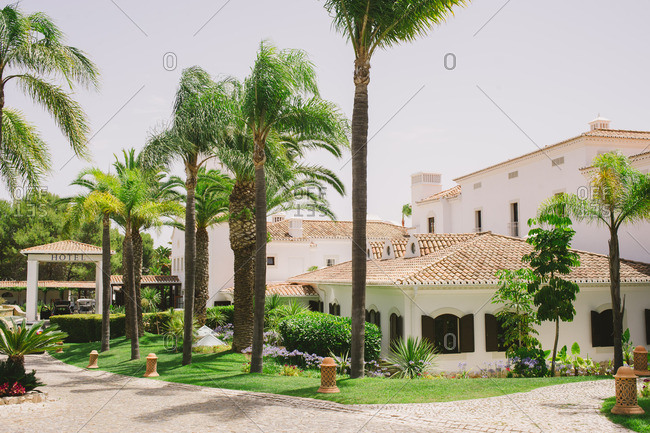 Algarve, Portugal - June, 24, 2017: Hotel entrance lined with palm trees