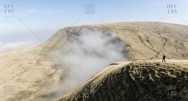 UK- Wales- Brecon Beacons- Young woman hiking at Bannau Sir Gaer Ridge