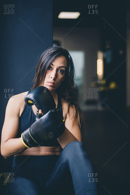 Portrait of a female boxer resting after boxing training