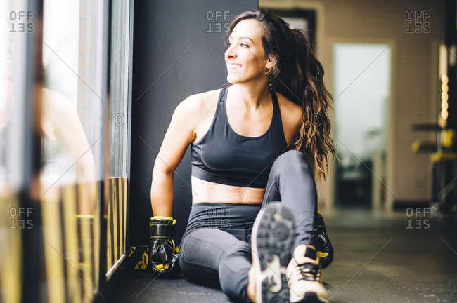 Smiling female boxer resting after boxing training
