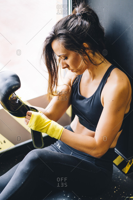 Female boxer resting after boxing training