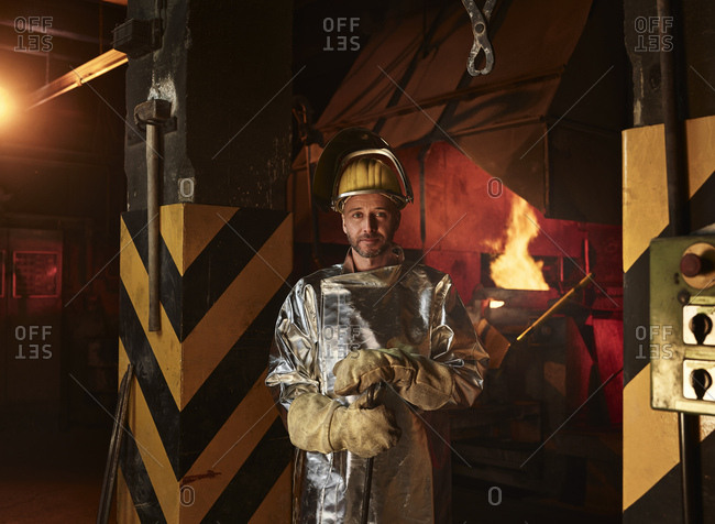 Portrait of confident worker wearing protective workwear standing in foundry