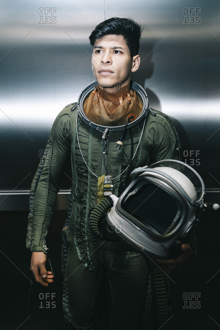 Man posing dressed as an astronaut in an elevator