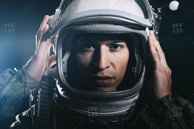 Man posing dressed as an astronaut in skyrocket elevator