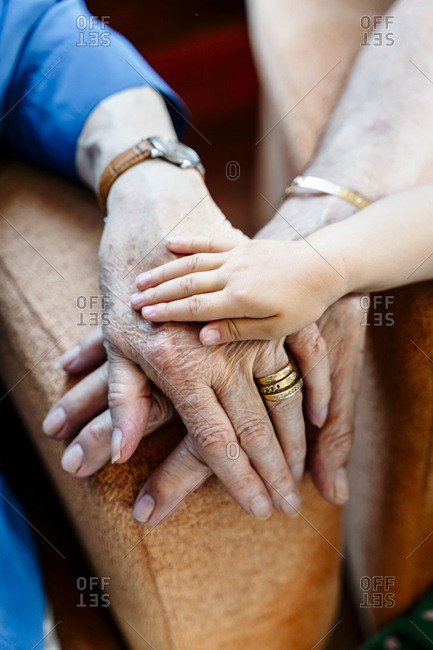 Elderly couple and baby's hand- generations together