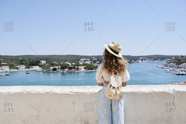 Rear view of young woman standing at view point- Menorca- Spain