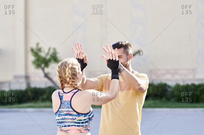 Man and woman finishing workout outdoors in the city