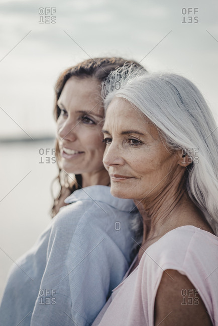 Mother and daughter spending a day at the sea- portrait