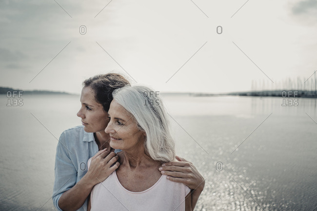 Mother and daughter spending a day at the sea