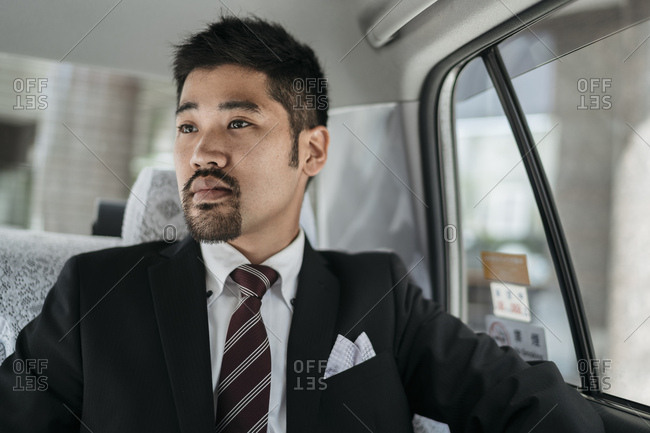 Young businessman in a taxi