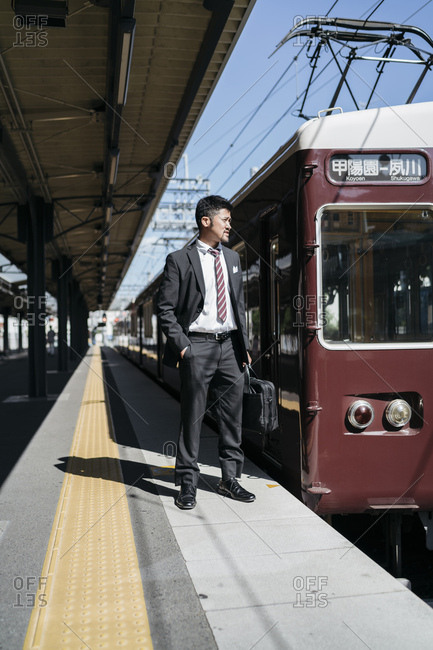Young businessman on a train platform