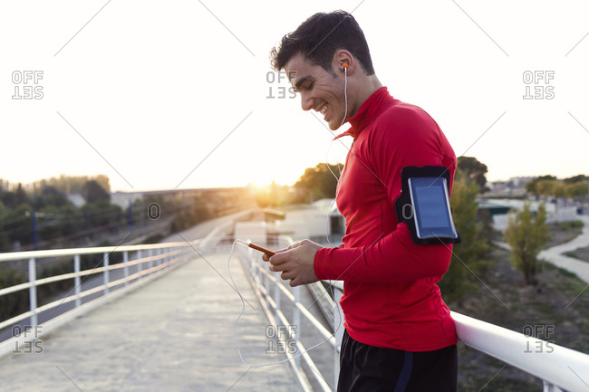 Jogger with smartphone in arm pocket
