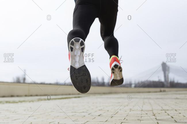 Jogger running- runner's feet- sole of shoe