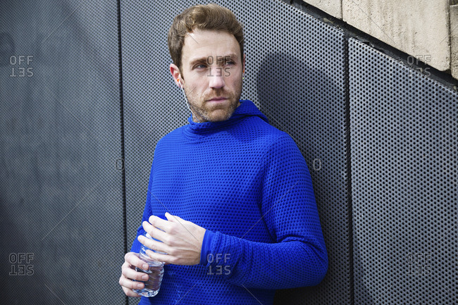 Portrait of jogger with water bottle