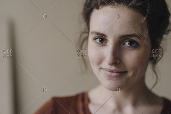 Portrait of smiling young woman with brown hair and eyes