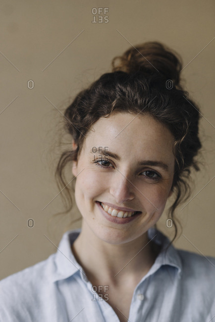 Portrait of smiling young woman with bun