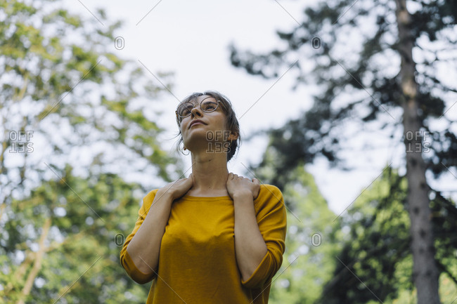 Young woman in a park looking up