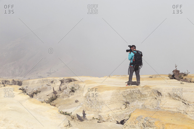 Man with camera- Ijen volcano- Java- Indonesia