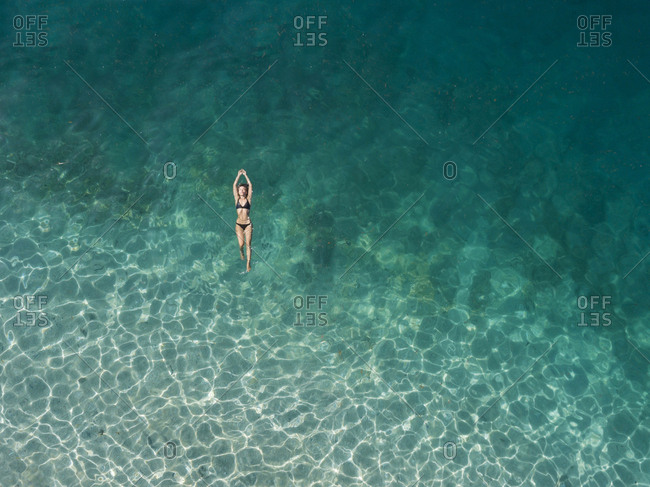 Woman floating in the sea- Gili Air- Gili Islands- Indonesia