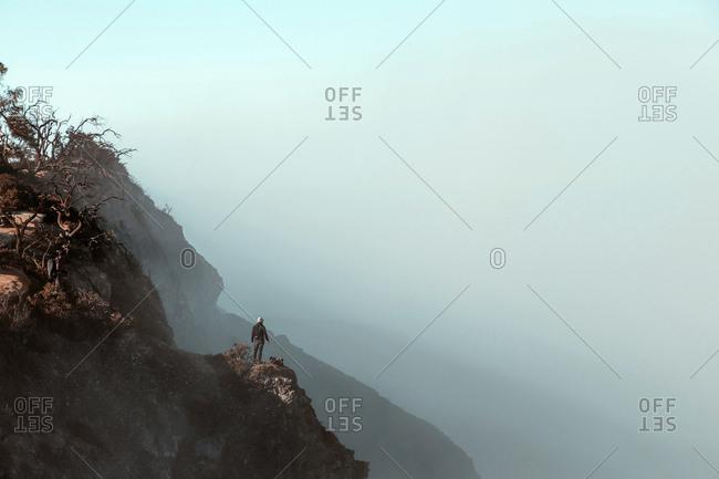 Man standing at Ijen volcano- Java- Indonesia