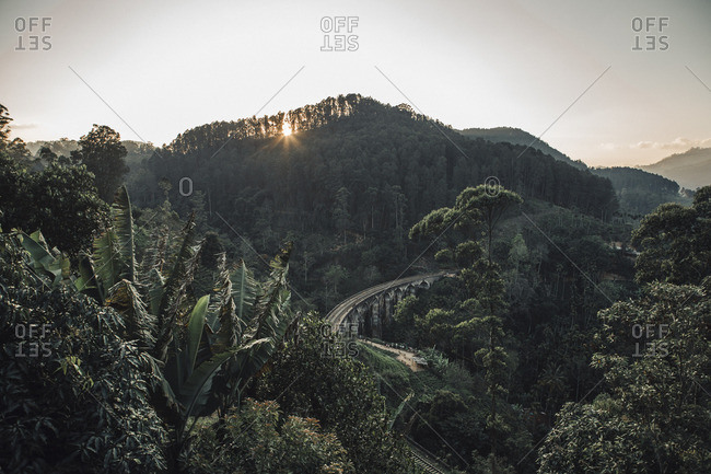High angle view of arch bridge amidst trees in forest against sky during sunset- Sri Lanka