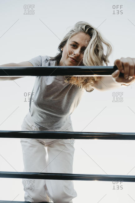 Young woman on a climbing frame- from above