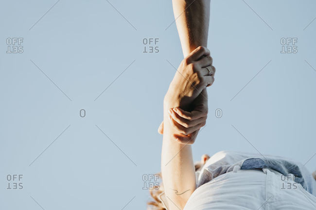 Young couple holding hands- from above
