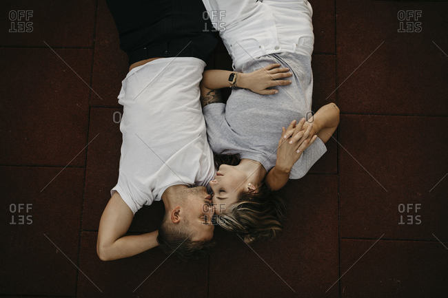 Young couple lying on the ground- from above