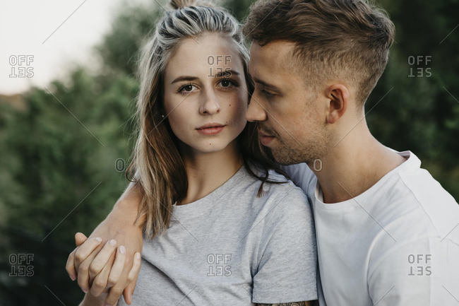 Portrait of young couple- arm around