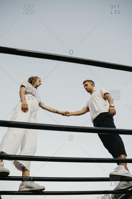 Young couple on a climbing frame- from above