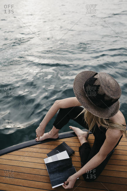 Woman with a book on a boat