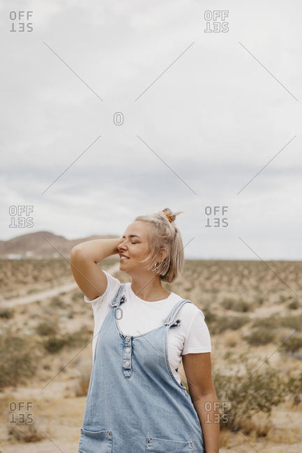 Young woman standing in desert landscape- Joshua Tree National Park- California- USA