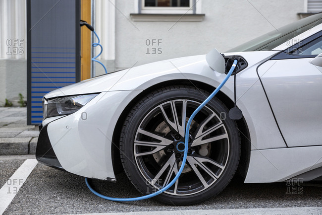 Electric car getting charged at an charging station