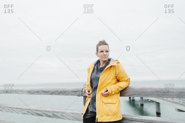 Young woman wearing yellow rain coat