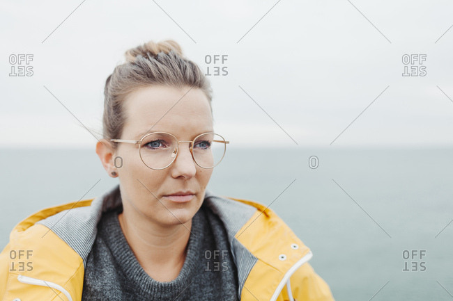 Portrait of blond woman wearing yellow rain jacket