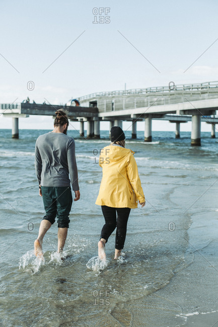 Couple walking at the beach in Heiligenhafen