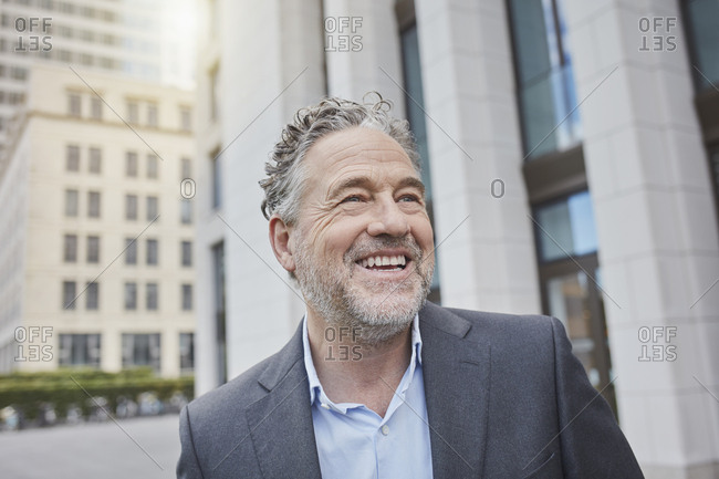 Portrait of happy businessman in the city