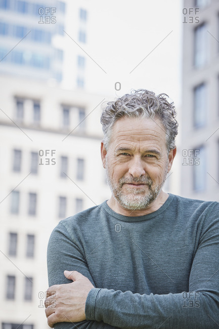 Portrait of confident mature man in the city
